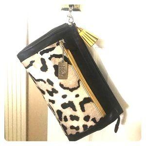 Coach leather clutch with Calf hair animal print